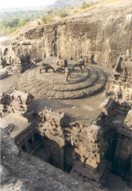 A closer look from south side of the area on the top of the main temple, see four lions and note design on all sides.