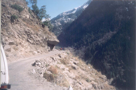 The road at times resembles a tunnel with one of the four walls missing. Cut out a sheer rock face!