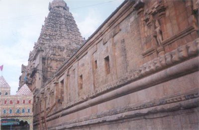 The temple proper rests on a raised plinth and consists of a sanctum cell where Lord Shiva is enshrined as a Linga. Side view of the plinth with the main temple in the background. It is a huge hall that has very good sculptures and leads you to the Linga