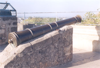 Picture of a Canon on top of the fort, had a range of 7 kms. The Upar Kot or Upper Fort situated on Rewatgiri hill, is girdled by a wall that is, in some places, over 20 m high.