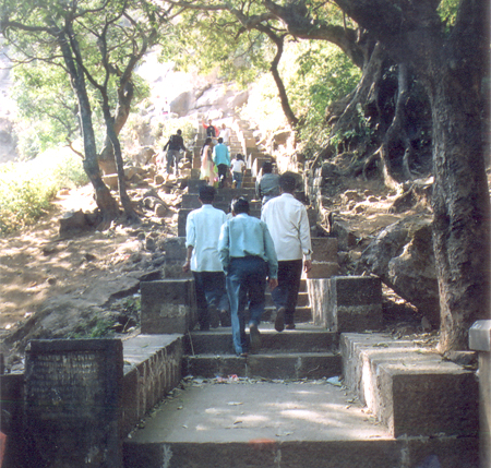 An important part of the trip is climbing Brahmagiri mountain and going to the point where river Godavari starts. Brahmagiri is considered a huge form of Lord Shiva & hence climbing the mountain was considered a sin. However in 1908 Seth Lalchand Bhambhani of Karachi & Seth Ganeshas built 500 steps of stone at a cost of Rs 40,000/ then. The mountain is 1800 feet high; its height from sea level is 4248 feet. What you see is the starting point of the steps.
