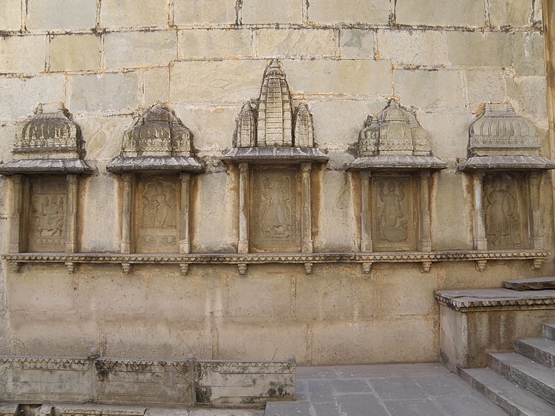 On either side of the entrance are carvings of the 10