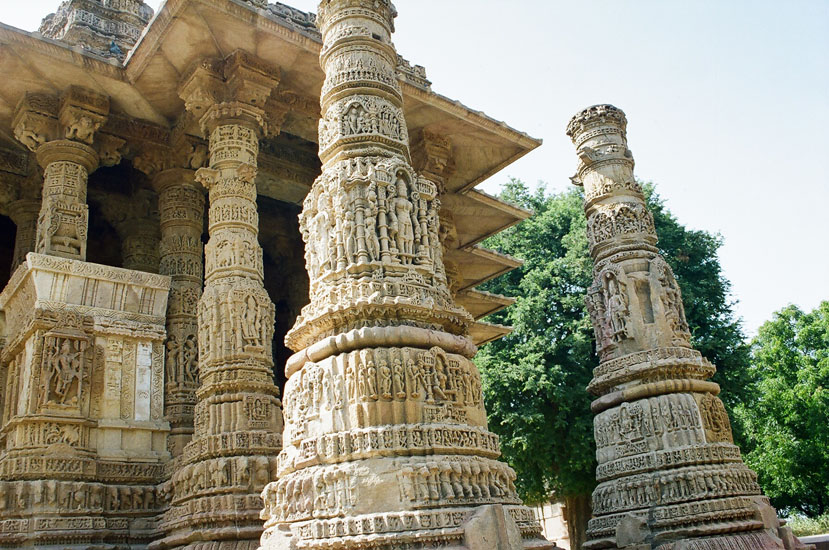 A close up of the columns that supported a Torana arches that no longer exist. This is the entrance to the Sabhamandapa when you enter from the Kund side. Note the intricate carvings. Modhera or Modherapura also known as Mundera is said to have been the original settlement of modha Brahmans.  Having its legendary past relating to the Ramayana it is further believed that modha Brahmans received Modhera as a krsnarpana on the occasion of the marriage of Rama and Sita.  According to the Skanda Purana (3.2.40-67) after defeating Ravana, Lord Rama consulted Muni Vasishta to show him a place of pilgrimage where he could go and purify himself of the sin of Brahma hatya (the slaying of a Brahman).  The Muni showed him dharmaranya.