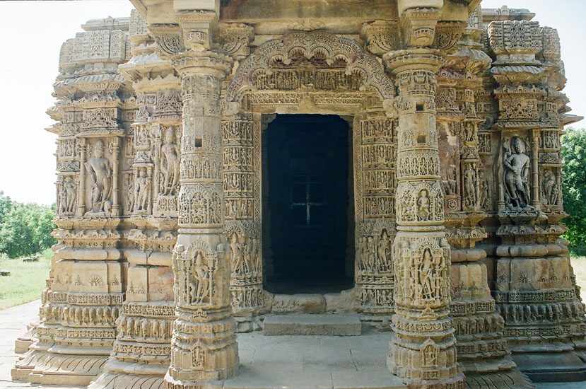 The closed mandapa has an octagonal arrangement of elegantly decorated tall pillars with ornamental torana – arches thrown across the axial pairs of pillars. This is the entrance to the Main Temple complex including sanctum with ambulatory, Kapili, closed Mandapa with lateral transepts and porch. The inner sanctum, which housed the presiding deity, faces east and was so designed that the solar equinoxes the first rays of the rising sun lit up the image of Surya. We were told the deity made in gold was taken away by Mahmud. Fortunately the toran arch at entrance is in tact.