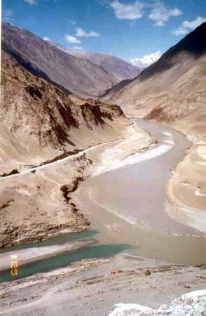 Confluence of Indus river (blue on right of picture) and the river flowing in is Zanskar. This picture is app 10 kms outside Leh on the Leh Srinagar highway.