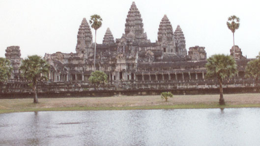 All five towers of the magnificent Angkor Wat temple are visible with the moat surrounding it.