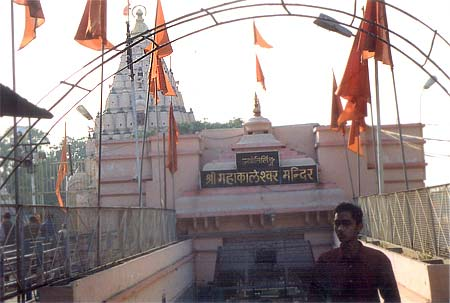 What you see is entrance to Mahakaleshwar Jyotirling.  Mahakala is the Lord of time and Death. One of the 12 jyotirlingas in India, the lingam at Mahakal is believed to be swayambhu (born of itself) deriving currents of power (shakti) from within itself as against the other images and lingams which are ritually established and invested with mantra-shakti.