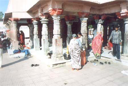 What you see are artistic pillars in the assembly hall of the temple that belong to the Parmar period (9-12th century). The temple was renovated by Ahilyabhai Holkar with the addition of a water tank and boundary wall. It is said that while returning to Ayodhya after victory over Ravana, Lord Ram rested here. To get rid of thirst, Lakshman dug out the water with his arrow. This is the reason the water tank is called Banganga.