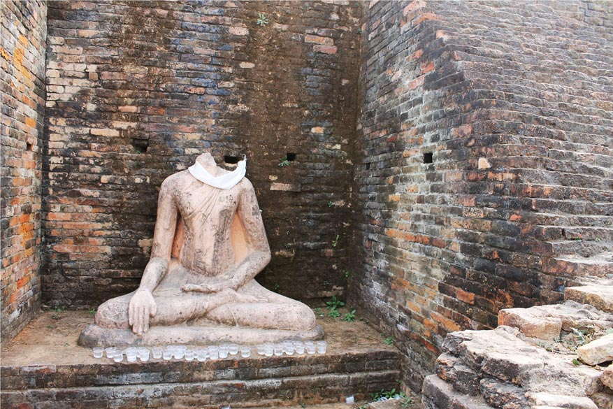 The exquisite, authentic and ancient statues of the Buddha at the kesariya stupa. Sadly the head of the statue was plundered in the middle ages.