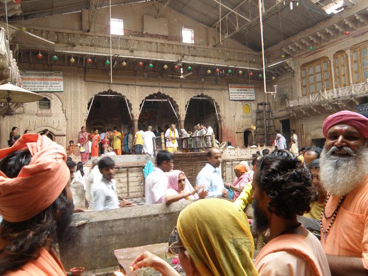 Inside the Radha Ballabh temple. The lady that you see right in front is placing fire on a stone that is a symbol of