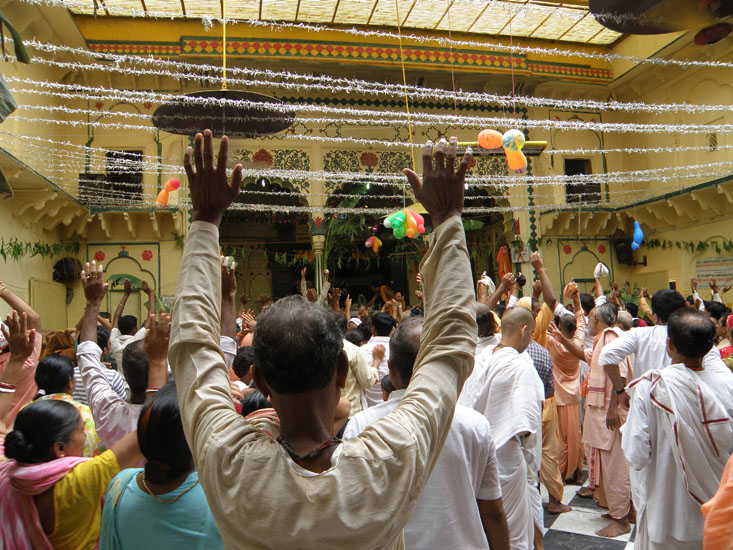 Inside the Sri Radha Damodar Mandir. You see devotees. Remember to do four parikramas of the temple. This temple includes the Deities of Radha Damodara, worshipped by Srila Jiva Goswami, the Deities of Radha Vrindavan Chandra of Krishna Dasa Kavirja Goswami, Radha Madhava of Jayadeva Goswami and Radha Chalcikana of Bhugarbha Goswami.