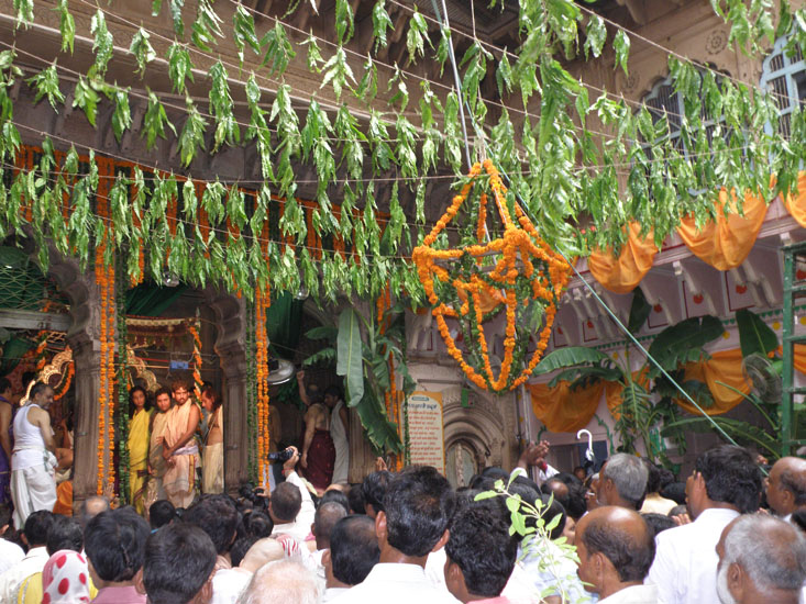 Crowds inside the Radha Ramani Mandir. The whole temple was decorated with marigold flowers.