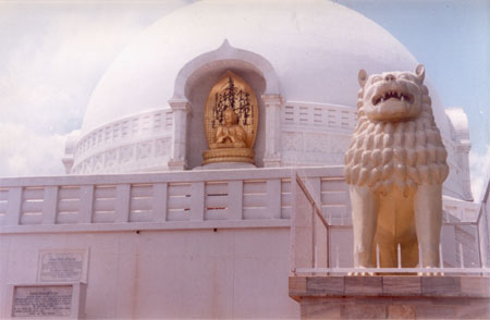 A closer view of the stupa. There are two lion statutes on either side of the entrance to the stupa. Reminds me of the Mysore Palace where there were two lions at the palace too.